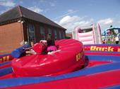 inflatable duel hire
